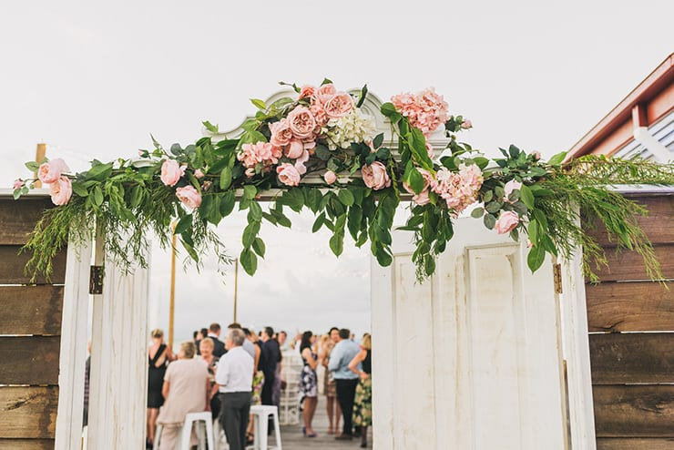 Vintage-Coastal-Wedding-Reception-Entrance-Flowers
