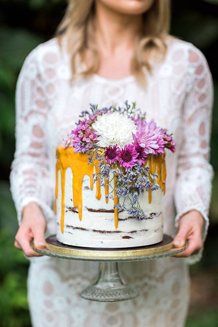 Caramel drip cake with pink floral topper