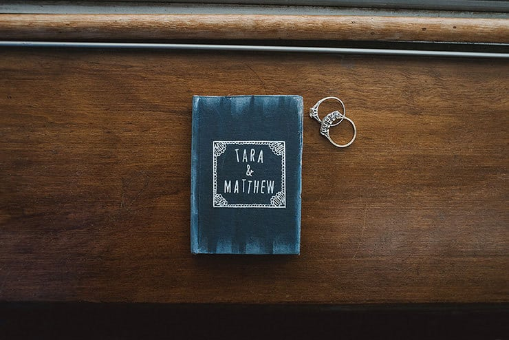 Personalised ceremony vow book and rings