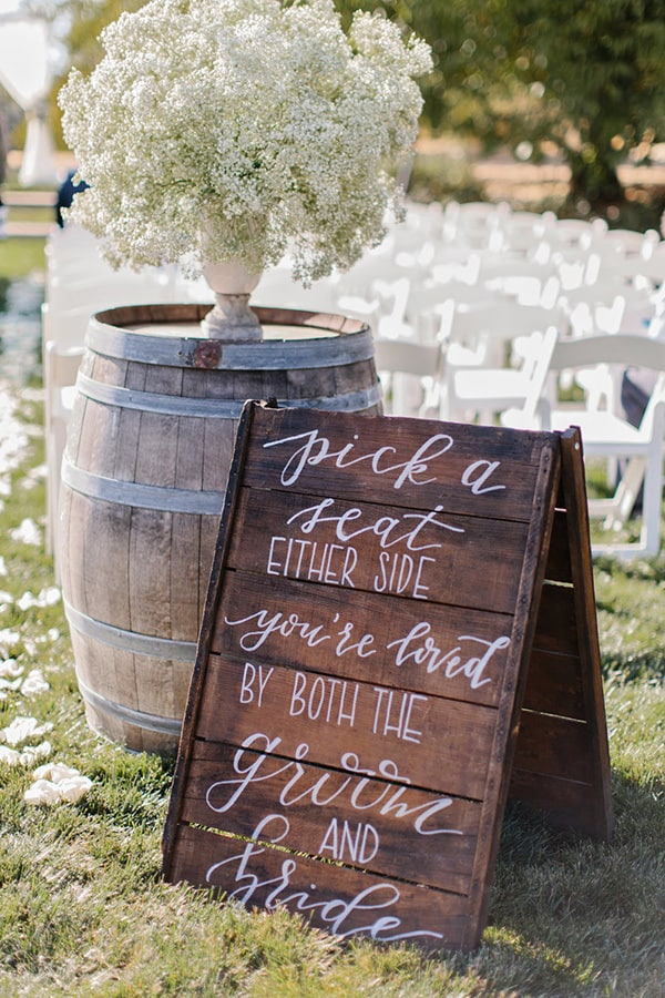 "Wedding ceremony seating sign - ""Pick a seat either side, you're loved by both the groom and bride."" 