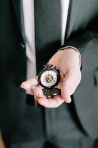Wedding keepsakes pocket watch with visible movement | Nattnee Photography