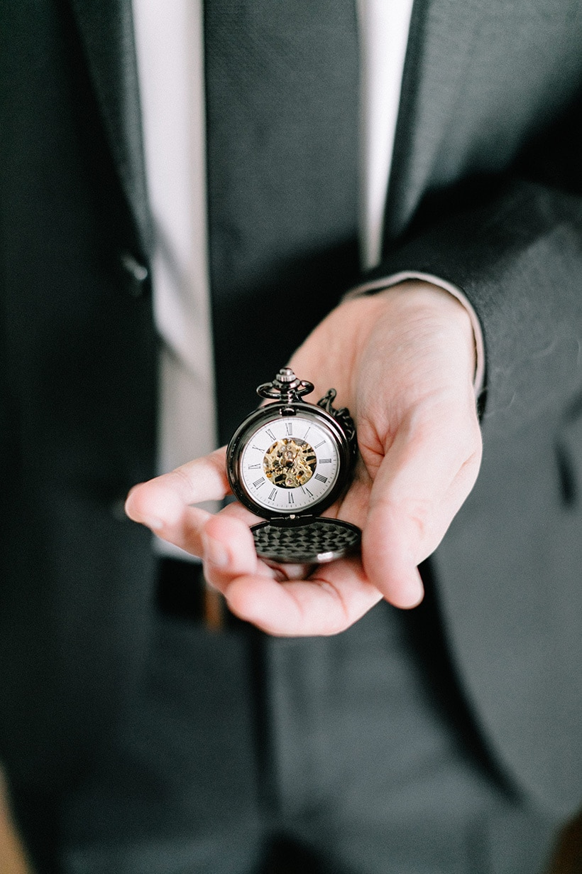 Vintage inspired pewter pocket watch with gold visible movement as a wedding keepsake for the groom | Nattnee Photography