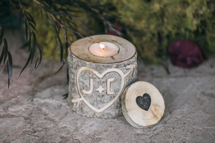 Wood stump candle holder engraved with bride and groom initials