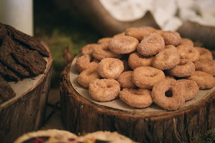 Wedding dessert table doughnuts on wood rounds