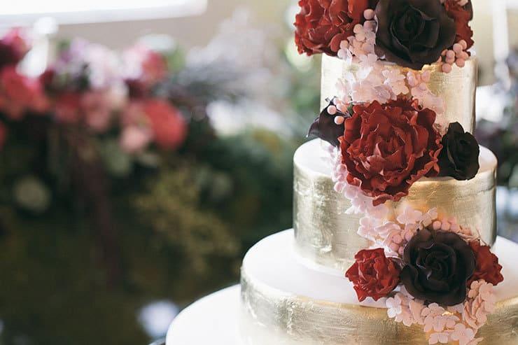 Gold wedding cake sugar flowers closeup