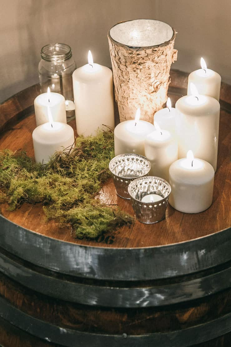 Wedding reception candle display on wine barrel